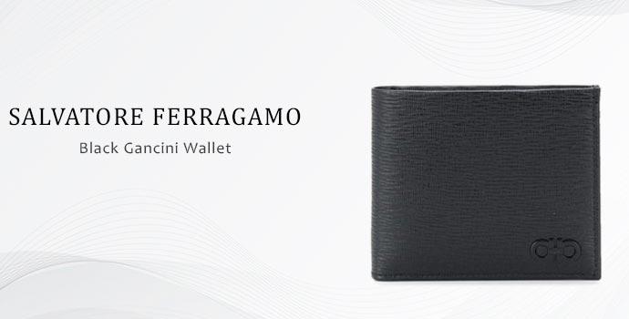 Black gancini wallet by Salvatore Ferragamo